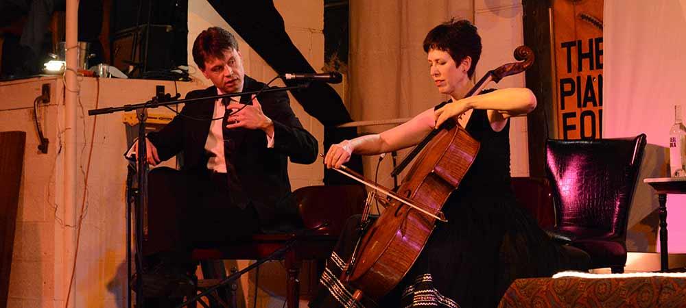 Diane Chaplin discusses cello technique with Leo [photo: JC CLinefelter]